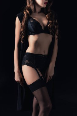 cropped view of woman posing in seductive lingerie isolated on black