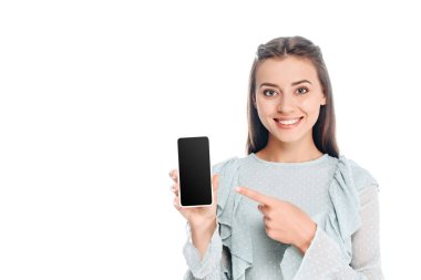 portrait of  smiling woman showing smartphone with blank screen isolated on white
