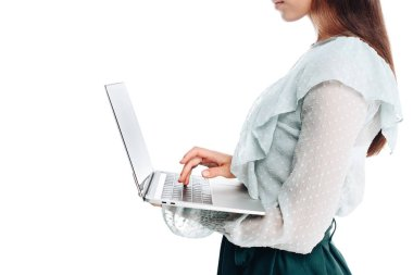 Cropped shot of woman using laptop isolated on white stock vector