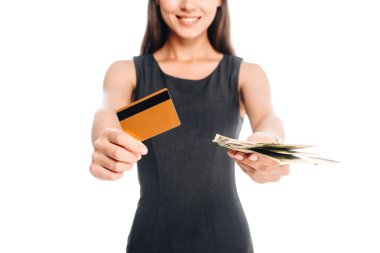 Cropped shot of smiling woman in black dress with credit card and cash isolated on white stock vector