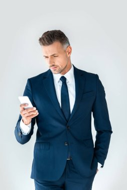 handsome businessman using smartphone isolated on white