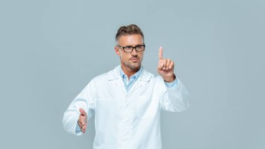 handsome scientist in glasses touching something isolated on grey, artificial intelligence concept