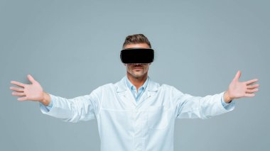 scientist in virtual reality headset holding something in air isolated on grey, artificial intelligence concept