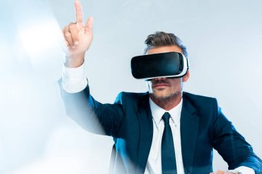 businessman in virtual reality headset touching something isolated on white, artificial intelligence concept