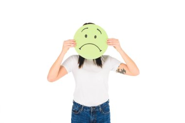 woman holding green sign with sad face expression isolated on white