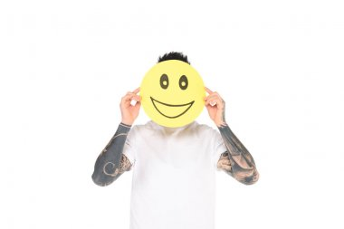 Man with tattoos holding card with smiling face expression isolated on white stock vector