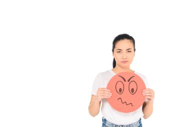 attractive girl holding red sign with confused face expression while looking at camera isolated on white