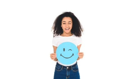 african american girl holding sign with winking face expression isolated on white