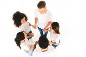 overhead view of multiethnic group of young people holding hands and standing in circle isolated on white