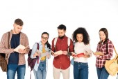 Fotografie multicultural group of people reading books and holding backpacks isolated on white