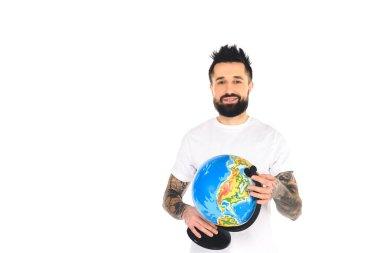 Smiling bearded tattooed man holding globe isolated on white stock vector
