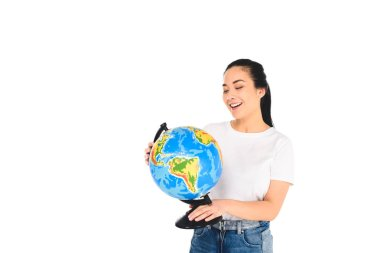 Smiling young woman looking at globe isolated on white stock vector
