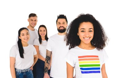 multiethnic group of young people standing behind african american woman with lgbt sign on t-shirt  isolated on white