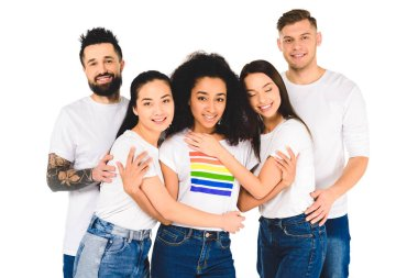 multiethnic group of young people smiling and hugging with african american woman with lgbt sign on t-shirt isolated on white