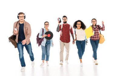 Cheerful multicultural group of young people with vinyl records and headhphones isolated on white stock vector