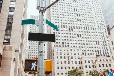 urban scene with traffic light, road signs and architecture of new york city, usa