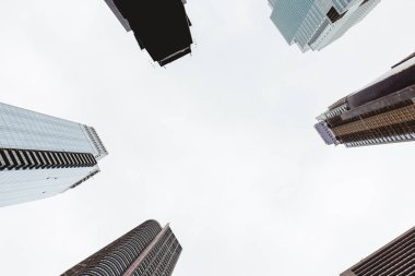 bottom view of skyscrapers and clear sky in new york city, usa
