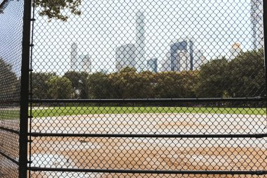 playground and buildings on background, new york, usa