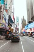 TIMES SQUARE, NEW YORK, USA - OCTOBER 8, 2018: urban scene with crowded times square in new york, usa