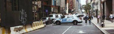 NEW YORK, USA - OCTOBER 8, 2018: panoramic view of new york street with police car, usa