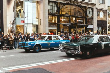 NEW YORK, USA - OCTOBER 8, 2018: city parade with police cars on street in new york, usa