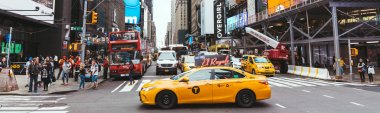 NEW YORK, USA - OCTOBER 8, 2018: panoramic view of yellow cabs and people in new york city, usa