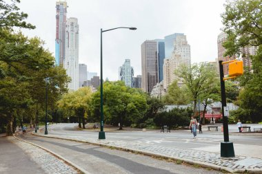 NEW YORK, USA - OCTOBER 8, 2018: urban scene with skyscrapers and city park in new york, usa