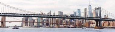 NEW YORK, USA - OCTOBER 8, 2018: panoramic view of manhattan and brooklyn bridge in new york, usa stock vector