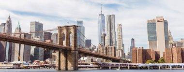 MANHATTAN, NEW YORK, USA - OCTOBER 8, 2018: panoramic view of manhattan and brooklyn bridge in new york, usa