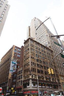 NEW YORK, USA - OCTOBER 8, 2018: low angle view of new york city street, usa stock vector