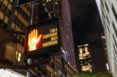 close up view of new york traffic light with i am a daydreamer and a nightthinker lettering, human hand sign and skyscrapers, usa