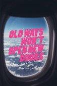 view of blue cloudy sky from airplane with old ways wont open new doors quote on window