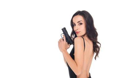 Attractive female killer in black dress holding gun, isolated on white stock vector