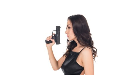 beautiful secret agent in black dress holding handgun, isolated on white