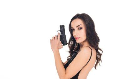 Beautiful secret agent in black dress holding gun, isolated on white stock vector