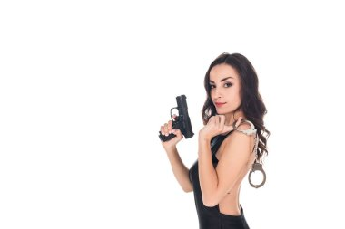 Beautiful security agent in black dress holding gun and handcuffs, isolated on white stock vector