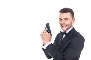 Cheerful secret agent in black suit holding gun, isolated on white stock vector