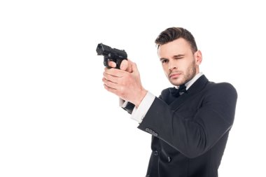 Dangerous killer in black suit aiming with gun, isolated on white stock vector