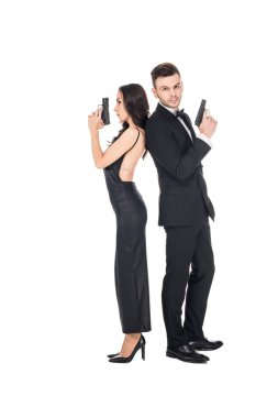 couple of secret agents posing with guns, isolated on white