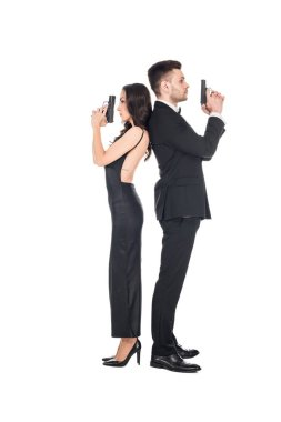 couple of secret agents in black clothes posing with weapon, isolated on white