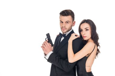 Beautiful woman embracing male secret agent with gun, isolated on white stock vector