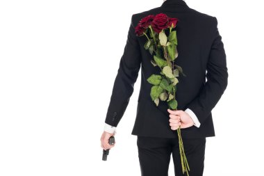 Back view of killer in black suit holding handgun and red rose flowers, isolated on white stock vector
