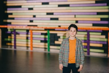 Selective focus of cute boy with colorful background