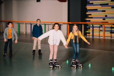 Excited kids in roller skates training together