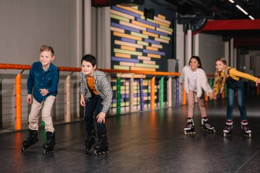 Joyful kids having fun while skating together