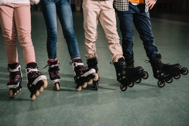 Partial view of children legs in roller skates