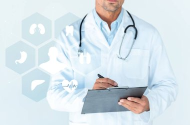 cropped image of doctor with stethoscope on shoulders writing something in clipboard isolated on white with medical interface