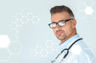portrait of handsome doctor in glasses with stethoscope on shoulders looking at camera isolated on white with medical symbols