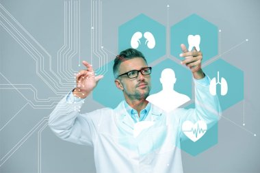 Handsome scientist in white coat and glasses moving medical interface in air isolated on white, artificial intelligence concept stock vector