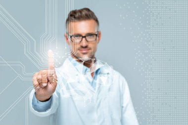 selective focus of handsome scientist touching brain interface in air isolated on white, artificial intelligence concept